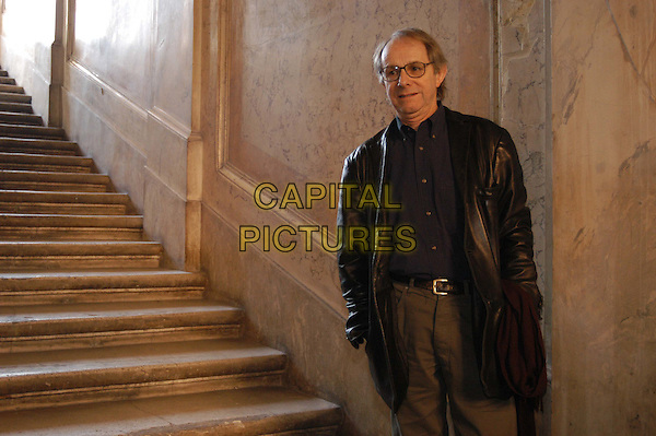 KEN LOACH.3 December 2003.black leather jacket, steps, stairs, half length, half-length.www.capitalpictures.com.sales@capitalpictures.com.© Capital Pictures