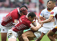 Huddersfield Giants' Sam Rapira is tackled by Wigan Warriors' Ben Flower (front) and Frank-Paul Nu'uausala <br /> Photographer Stephen White/CameraSport<br /> <br /> Betfred Super League Round 5 - Wigan Warriors v Huddersfield Giants - Sunday 19th March 2017 - DW Stadium - Wigan<br /> <br /> World Copyright &copy; 2017 CameraSport. All rights reserved. 43 Linden Ave. Countesthorpe. Leicester. England. LE8 5PG - Tel: +44 (0) 116 277 4147 - admin@camerasport.com - www.camerasport.com
