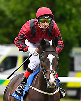 Escape The City ridden by Gerald Mosse goes down to the start of The British Stallion Studs EBF Margadale Fillies' Handicap during Evening Racing at Salisbury Racecourse on 11th June 2019