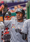 7 April 2016: Miami Marlins outfielder Marcell Ozuna returns to the dugout after scoring in the first inning of the Washington Nationals Home Opening Game at Nationals Park in Washington, DC. The Marlins defeated the Nationals 6-4 in their first meeting of the 2016 MLB season. Mandatory Credit: Ed Wolfstein Photo *** RAW (NEF) Image File Available ***