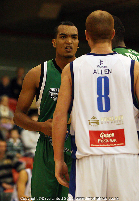 Manawatu's Marcel Jones has a small disagreement with Hayden Allen during the NBL Round 5 match between the Manawatu Jets  and Auckland Stars at Arena Manawatu, Palmerston North, New Zealand on Friday 10 April 2009. Photo: Dave Lintott / lintottphoto.co.nz