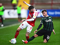 Fleetwood Town's Wes Burns is tackled by Plymouth Argyle's Graham Carey<br /> <br /> Photographer Richard Martin-Roberts/CameraSport<br /> <br /> The EFL Sky Bet League One - Fleetwood Town v Plymouth Argyle - Saturday 16th March 2019 - Highbury Stadium - Fleetwood<br /> <br /> World Copyright © 2019 CameraSport. All rights reserved. 43 Linden Ave. Countesthorpe. Leicester. England. LE8 5PG - Tel: +44 (0) 116 277 4147 - admin@camerasport.com - www.camerasport.com
