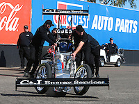 Feb 3, 2016; Chandler, AZ, USA; Crew members with NHRA top fuel driver Dave Connolly during pre season testing at Wild Horse Pass Motorsports Park. Mandatory Credit: Mark J. Rebilas-USA TODAY Sports