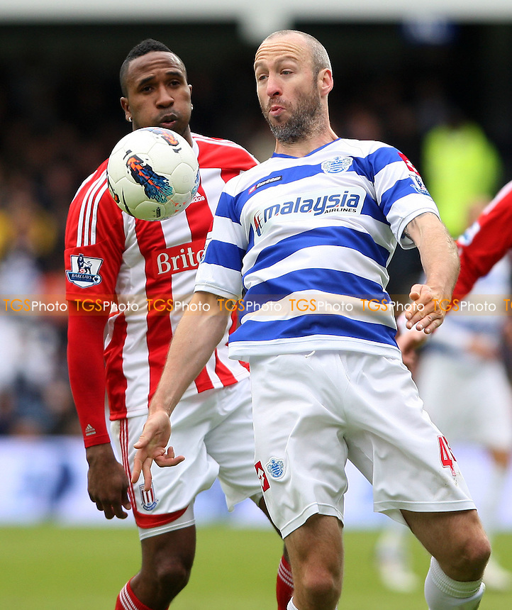 Shaun Derry of QPR shields the ball from Ricardo Fuller of Stoke - Queens Park Rangers vs Stoke City, Barclays Premier League at Loftus Road, London - 06/05/12 - MANDATORY CREDIT: Rob Newell/TGSPHOTO - Self billing applies where appropriate - 0845 094 6026 - contact@tgsphoto.co.uk - NO UNPAID USE..