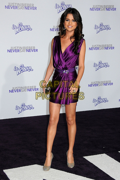 "SELENA GOMEZ .""Justin Bieber: Never Say Never"" Los Angeles Premiere held at Nokia Theater L.A. Live, Los Angeles, California, USA, .8th February 2011..full length purple silk satin mini dress sleeveless clutch bag silver shoes  jewelled jewel glittery sparkly .CAP/ADM/BP.©Byron Purvis/AdMedia/Capital Pictures."