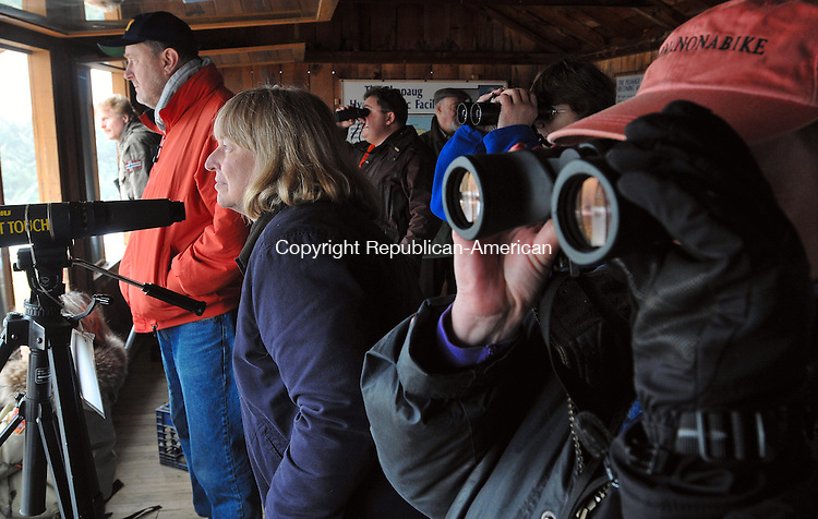 SOUTHBURY, CT-122708JS01-Jim and Penny Szczechowski of Traverse City, Michigan, left, and volunteer Linda Nash of Newtown, peer through Saturday's fog to watch the bald eagles during opening day of bald eagle watching at the Shepaug Dam viewing station in Southbury. <br /> Jim Shannon / Republican-American
