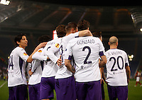 Calcio, Europa League: Ritorno degli ottavi di finale Roma vs Fiorentina. Roma, stadio Olimpico, 19 marzo 2015.<br /> Fiorentina's Gonzalo Rodriguez, second from left, n. 2, celebrates with teammates after scoring on a penalty kick  during the Europa League round of 16 second leg football match between Roma and Fiorentina at Rome's Olympic stadium, 19 March 2015.<br /> UPDATE IMAGES PRESS/Isabella Bonotto