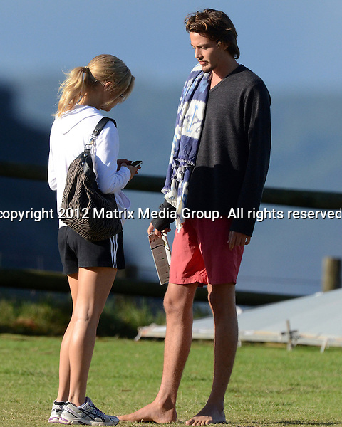 9 APRIL 2013 SYDNEY AUSTRALIA ..EXCLUSIVE PICTURES..Samara Weaving pictured on set at Palm Beach for filming of Home & Away. Samara seems to have herself a hunky new boyfriend who sat around and waiting for her to finish her scenes. While he waited the boyfriend took a swim and read a book. Later the pair were photographed arriving together at Carriageworks for Mercedes Benz Fashion Week...*No internet without clearance*.MUST CALL PRIOR TO USE ..+61 2 9211-1088.Matrix Media Group.Note: All editorial images subject to the following: For editorial use only. Additional clearance required for commercial, wireless, internet or promotional use.Images may not be altered or modified. Matrix Media Group makes no representations or warranties regarding names, trademarks or logos appearing in the images.