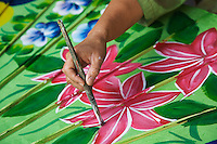Female artist hand painting ecorative umbrella, Umbrella Making Center, Bo Sang, just outside Chiang Mai, Thailand