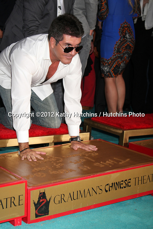 LOS ANGELES - SEP 11:  Simon Cowell at the FOX  X-Factor Judges Handprint Ceremony at Graumans Chinese Theater on September 11, 2012 in Los Angeles, CA