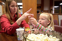 NWA Democrat-Gazette/BEN GOFF @NWABENGOFF<br /> Terrilyn Wendling, assistant director of the Rogers Historical Museum, helps her daughter Ashlyn Wendling, 2, make a popcorn garland on Sunday Nov. 29, 2015 during the annual open house at the Rogers Historical Museum.