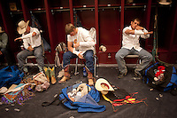 Bareback rider J.R. Vezain, left, and other riders ready equipment before competing at the College National Finals Rodeo in Casper, Wyo., Saturday, June 18, 2011. Unlike college athletes in other sports, student rodeo atheletes are allowed to compete for money and sign with sponsors. (Kevin Moloney for the New York Times)
