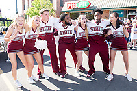 Cheerleaders singing before the even begins.<br />  (photo by Beth Wynn / &copy; Mississippi State University)
