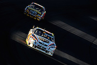 Mar 2, 2008; Las Vegas, NV, USA; NASCAR Sprint Cup Series driver Dale Jarrett leads Elliott Sadler during the UAW Dodge 400 at Las Vegas Motor Speedway. Mandatory Credit: Mark J. Rebilas-US PRESSWIRE