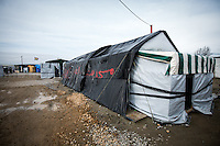 """The Mosque.<br /> <br /> Calais Jungle Camp.<br /> <br /> Under the Sky of Calais & Dunkirk. Two Camps, Two Sides of the Same Coin: Not 'migrants', Not 'refugees', just Humans.<br /> <br /> France, 24-30/03/2016. Documenting (and following) Zekra and her experience in the two French camps at the gate of the United Kingdom: Calais' """"Jungle"""" and Dunkirk's """"Grande-Synthe"""". Zekra lives in London but she is originally from Basra in Iraq. Zekra and her family had to flee Kuwait - where they moved for working reason - due to the """"Gulf War"""", and to the Western Countries' will to """"export Democracy in Iraq"""". Zekra is a self-motivated volunteer and founder of """"Happy Ravers"""", a group of people (not a NGO or a charity) linked to each other because of their love for rave parties but also men and women who meet up every week to help homeless people and other people in need in Central London. (Here there are some of the stories I covered about Zekra and """"Happy Ravers"""": http://bit.ly/1XVj1Cg & http://bit.ly/24kcGQz & http://bit.ly/1TY0dPO). Zekra worked as an English teacher in the adult school at Dunkirk's """"Grande-Synthe"""" camp and as a cultural mediator and Arabic translator for two medic teams in Calais' """"Jungle"""". Please read her story at the beginning of this reportage."""