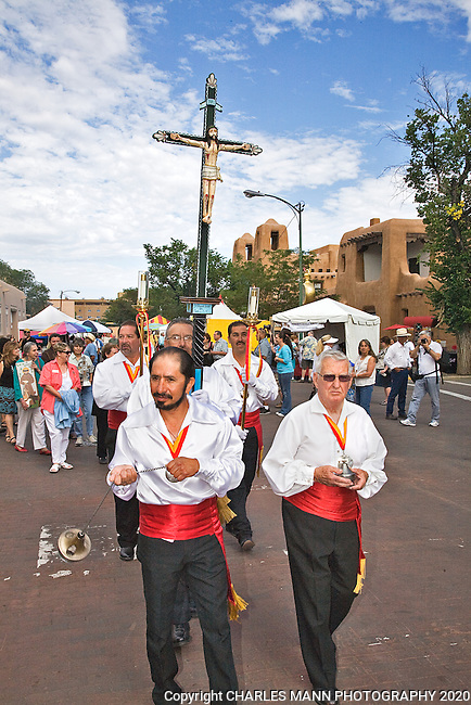 The Santa Fe Spanish Market, held in July, fills the Santa Fe Plaza with artists parton and visitors all celebrating traditional Spanish colonial arts. It is held side by side with the Contemporary Spanish Market which features modern Hispanic artists. The Sunday Procession is led me men of the church followed by a large group of of artsts.