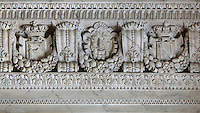 Sculpted marble frieze with satyrs, initials and fruit garlands, 1834, by Jean-Baptiste Louis Plantar, 1790-1879, in the antechamber of the Chapelle de la Trinite or Chapel of the Trinity, Chateau de Fontainebleau, France. The Palace of Fontainebleau is one of the largest French royal palaces and was begun in the early 16th century for Francois I. It was listed as a UNESCO World Heritage Site in 1981. Picture by Manuel Cohen