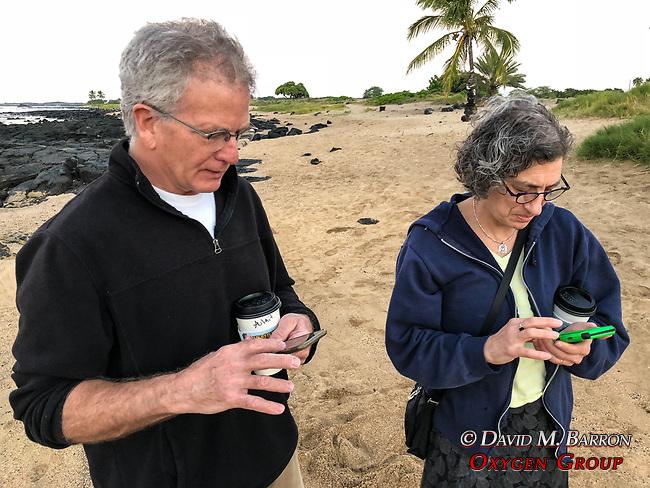 John & Debora On Thier Phones