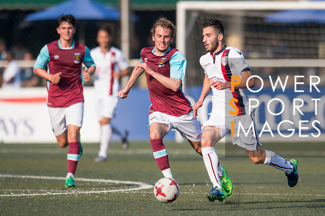 West Ham United (in purple) vs Cagliari Calcio (in white) during their Main Tournament Shield Final match, part of the HKFC Citi Soccer Sevens 2017 on 28 May 2017 at the Hong Kong Football Club, Hong Kong, China. Photo by Marcio Rodrigo Machado / Power Sport Images