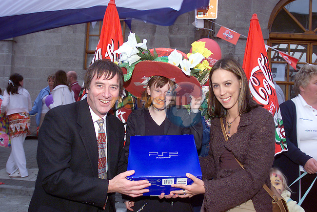 katelyn Hodgins centre with her new PS2 which she won for best hat at the Costa Rican Street party Sponsored by Drogheda Concentrates Pictured with Hugo Reedy General Manager Drogheda Concentrates and Caoimhe Mulroy Judge..Photo Fran Caffrey/Newsfile.ie..This picture has been sent to you by:.Newsfile Ltd,.3 The View,.Millmount Abbey,.Drogheda,.Co Meath..Ireland..Tel: +353-41-9871240.Fax: +353-41-9871260.GSM: +353-86-2500958.ISDN: +353-41-9871010.IP: 193.120.102.198.www.newsfile.ie..email: pictures@newsfile.ie..This picture has been sent by Fran Caffrey.francaffrey@newsfile.ie