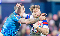 Picture by Allan McKenzie/SWpix.com - 09/02/2018 - Rugby League - Betfred Super League - Wakefield Trinity v Salford Red Devils - The Mobile Rocket Stadium, Wakefield, England - Wakefield's Danny Kirmond fends off Salford's Luke Burgess.