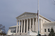 Washington, DC - February 19, 2016: The U.S. flag flies at half-staff as the late Associate Justice Antonin Scalia's body lay in repose inside the Great Hall of the Supreme Court in the District of Columbia, February 19, 2016.   (Photo by Don Baxter/Media Images International)