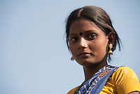 Portrait of a village girl in a colourful sari at a tribal village in Madhya Pradesh, India.