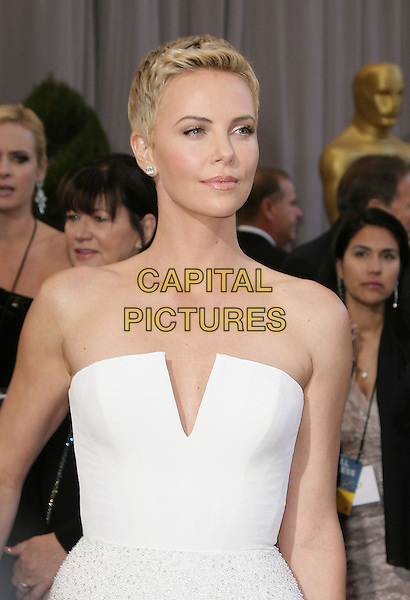 Charlize Theron (wearing Dior Couture).85th Annual Academy Awards held at the Dolby Theatre at Hollywood & Highland Center, Hollywood, California, USA..February 24th, 2013.oscars half length dress white strapless short cropped hair pixie cut .CAP/ADM.©AdMedia/Capital Pictures.