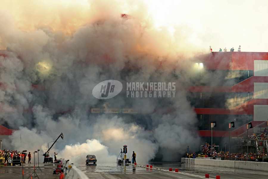 Jun 17, 2017; Bristol, TN, USA; NHRA jet funny car driver David Douthit shoots smoke from his jet engine into the tower suites during qualifying for the Thunder Valley Nationals at Bristol Dragway. Mandatory Credit: Mark J. Rebilas-USA TODAY Sports