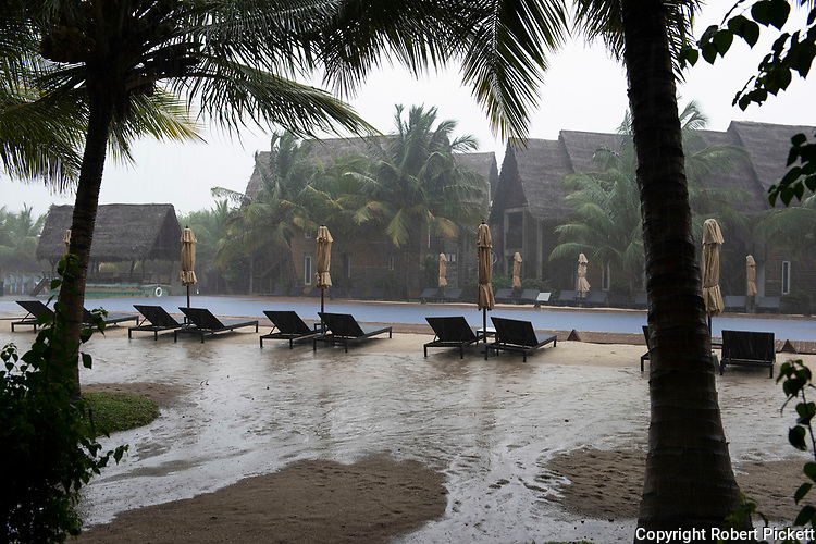 Rain Storm in hotel grounds by swimming pool, showing flooding, Pasikudha Bay, Kalkudah, Sri Lanka