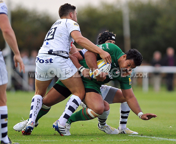 Ofisa Treviranus is tackled to ground. Pre-season friendly match, between London Irish and Bristol Rugby on August 22, 2014 at Hazelwood in Middlesex, England. Photo by: Patrick Khachfe / JMP
