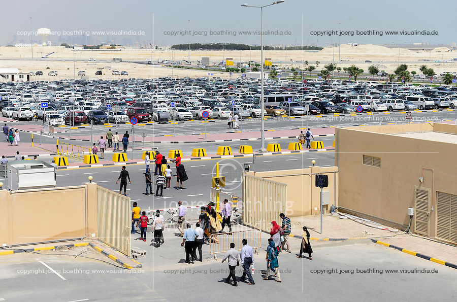 QATAR, Doha, religious complex with churches, parkin place / KATAR, Doha, Religionskomplex mit Kirchen am Stadtrand, Parkplatz und Wolkenkratzer der Eastbay im Hintergrund