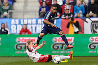 Alex (71) of the Chicago Fire crosses a ball as Dax McCarty (11) of the New York Red Bulls slides to block during the first half. The New York Red Bulls defeated the Chicago Fire 5-2 during a Major League Soccer (MLS) match at Red Bull Arena in Harrison, NJ, on October 27, 2013.