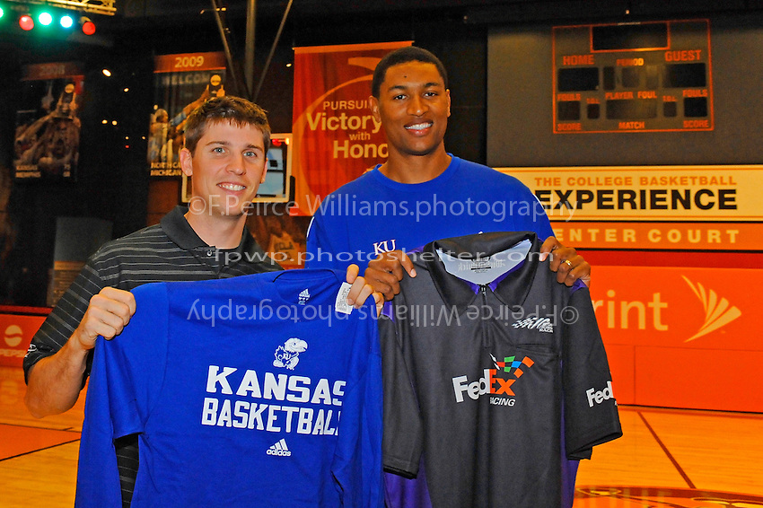 30 September, 2010, Kansas City, Kansas USA.Denny Hamlin exchanges jerseys with Wayne Simien, The College Basketball Experience..©2010, F. Peirce Williams, USA.