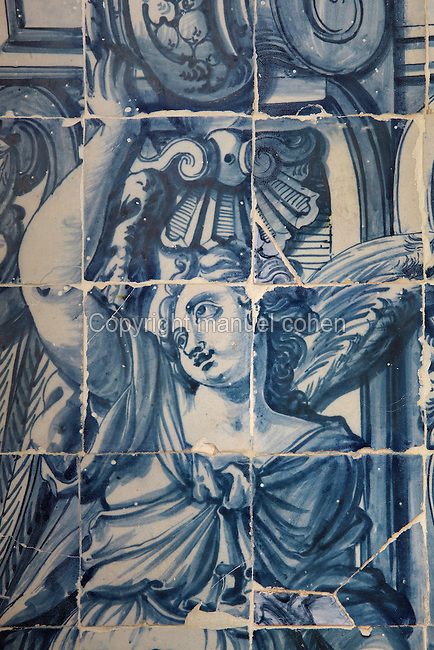 Decorative detail of woman from a border, traditional blue and white azulejos tile scene, 18th century, part of a series depicting the history of the monastery and the Siege of Lisbon in 1147, in the Monastery of Sao Vicente de Fora, an Augustinian order monastery and church built in the 17th century in Mannerist style, Lisbon, Portugal. The monastery also contains the royal pantheon of the Braganza monarchs of Portugal. Picture by Manuel Cohen