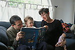 "Berkeley, CA Parents enjoying ""The Cat in the Hat"" with daughter twenty months old, mother pregnant, holding child's baby doll MR"