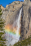 Rainbow forms in the spray of Upper Yosemite Falls.