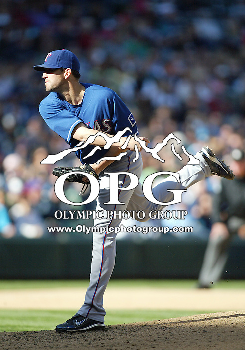 04 October 2009: Texas Rangers relief pitcher Darren O'Day fires the ball to the plate against the Seattle Mariners . Seattle won 4-3 over the Texas Rangers at Safeco Field in Seattle, Washington.