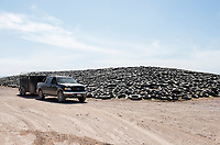Car and truck tires used for the system of silos to store and ferment cattle feed. El Principal ranch, the biggest ranch providing milk to Alpura, Delicias, Chihuahua, Mexico