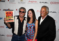 Aug. 29, 2013; Avon, IN, USA: NHRA NHRA funny car driver John Force (left), wife Laurie Force (center) and Don Prudhomme on the red carpet prior to the premiere of Snake & Mongoo$e at the Regal Shiloh Crossing Stadium 18. Mandatory Credit: Mark J. Rebilas-