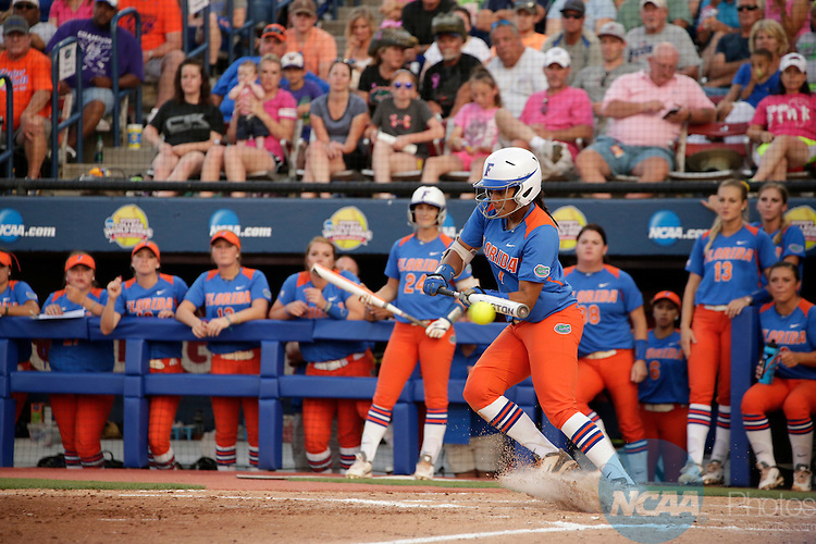 02 JUNE 2014:   Kelsey Stewart (7) of the University of Florida lays down a bunt for a hit against the University of Alabama during the Division I Women's Softball Championship held at ASA Hall of Fame Stadium in Oklahoma City, OK.  Shane Bevel/NCAA Photos