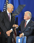 "Washington, D.C. - April 21, 2009 -- United States Senator Orrin Hatch (Republican of Utah), left, and U.S. Senator Edward M. ""Ted"" Kennedy (Democrat of Massachusetts), right, share a thought as U.S. President Barack Obama (not pictured) makes remarks at the signing ceremony for the Edward M. Kennedy Serve America Act at the SEED School in Washington, D.C. on Tuesday, April 21, 2009..Credit: Ron Sachs / CNP"
