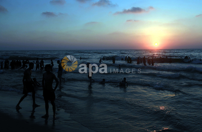 Palestinians enjoy swimming in the sea on Gaza's beach on 27 June 2012 in Gaza City . Photo by Majdi Fathi
