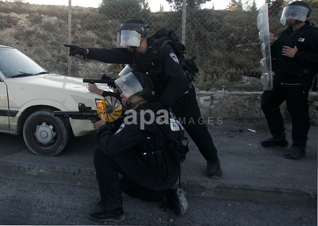 Israeli security forces take up positions during clashes with Palestinian youths in the east Jerusalem neighborhood of Issawiyeh, Friday, Dec. 3, 2010. The clashes started after a protest against Israel's house demolitions in Issawiyeh. Photo by Mahfouz Abu Turk