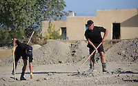 Pictured: Special forensics police officers use rakes to search through soil in a field in front of the house where Ben Needham disappeared from (BACKGROUND), in Kos, Greece. Tuesday 04 October 2016<br /> Re: Police teams led by South Yorkshire Police, searching for missing toddler Ben Needham on the Greek island of Kos have moved to a new area in the field they are searching.<br /> Ben, from Sheffield, was 21 months old when he disappeared on 24 July 1991 during a family holiday.<br /> Digging has begun at a new site after a fresh line of inquiry suggested he could have been crushed by a digger.
