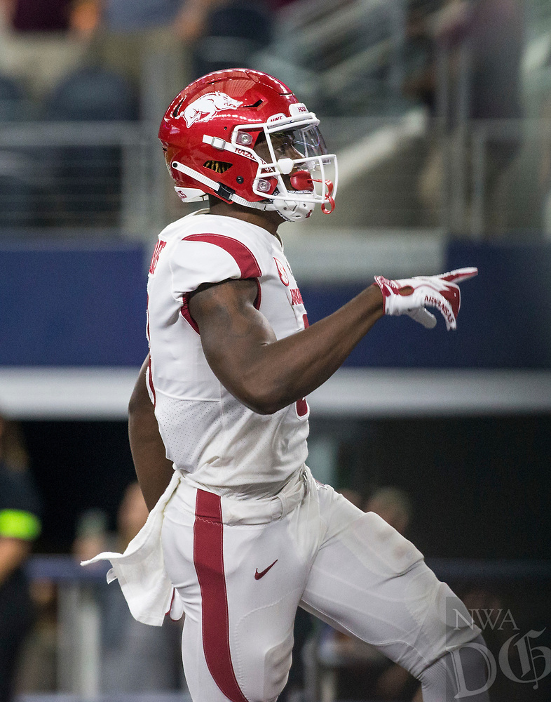 Hawgs Illustrated/Ben Goff<br /> Mike Woods, Arkansas wide receiver, celebrates after a 29-yard touchdown catch in the 4th quarter vs Texas A&M Saturday, Sept. 29, 2018, during the Southwest Classic at AT&T Stadium in Arlington, Texas.