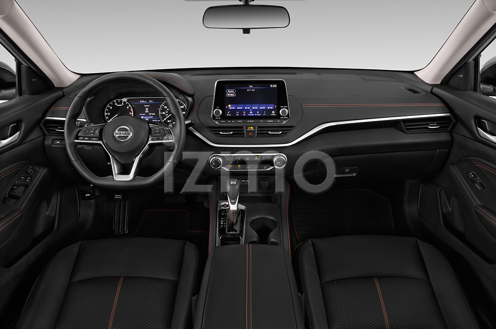 Stock photo of straight dashboard view of 2019 Nissan Altima SR-FWD 4 Door Sedan Dashboard