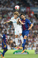 Real Madrid's Croatian midfielder Luca Modric and FC Barcelona´s Portuguese midfielder Andre Gomes