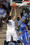 26 February 2012: North Carolina's Chay Shegog (20) shoots over Duke's Elizabeth Williams (1). The Duke University Blue Devils defeated the University of North Carolina Tar Heels 69-63 at Carmichael Arena in Chapel Hill, North Carolina in an NCAA Division I Women's basketball game.
