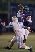 NWA Democrat-Gazette/CHARLIE KAIJO Fayetteville High School quarterback Darius Bowers (5) looks for a receiver during a playoff football game on Friday, November 10, 2017 at Fayetteville High School in Fayetteville.